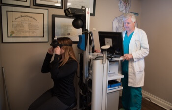 Dr. running tests on female patient brain health