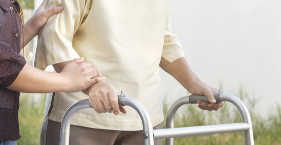 Man being using a walker for his neuro disorder