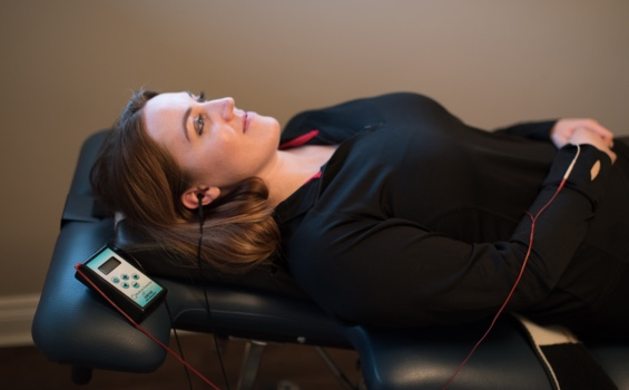 A patient undergoing transcranial treatment at Broadview Spine & Health Centre