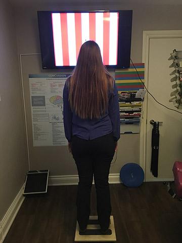 Girl in vestibular rehabilitation