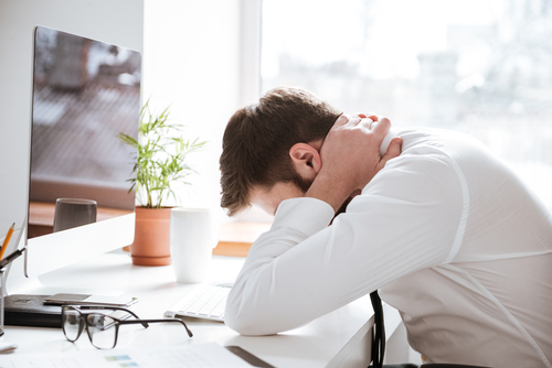 man fatigued at work from concussion