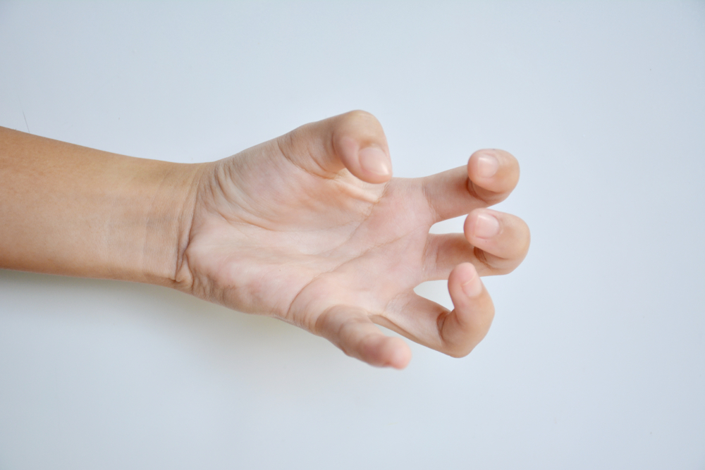 patient with dystonia hand twitching