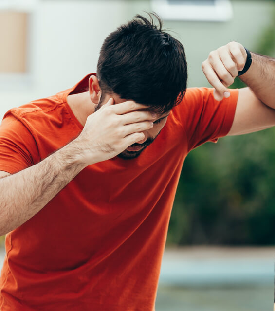 Man holding his head and showing signs of a concussion