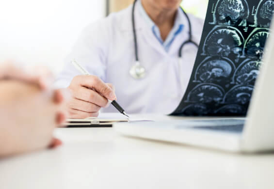 a physician overlooking a concussion treatment plan for an athlete