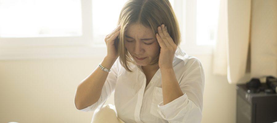 woman suffers headache from concussion