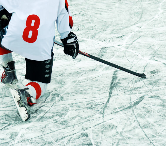 A hockey player takes a knee after suffering a concussion