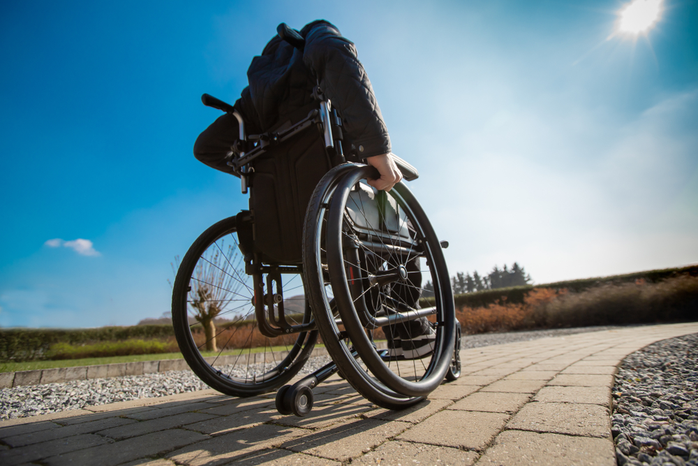 person with focal dystonia in wheelchair