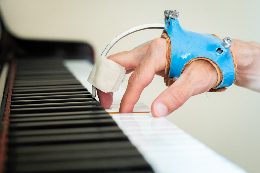 person playing piano with focal dystonia