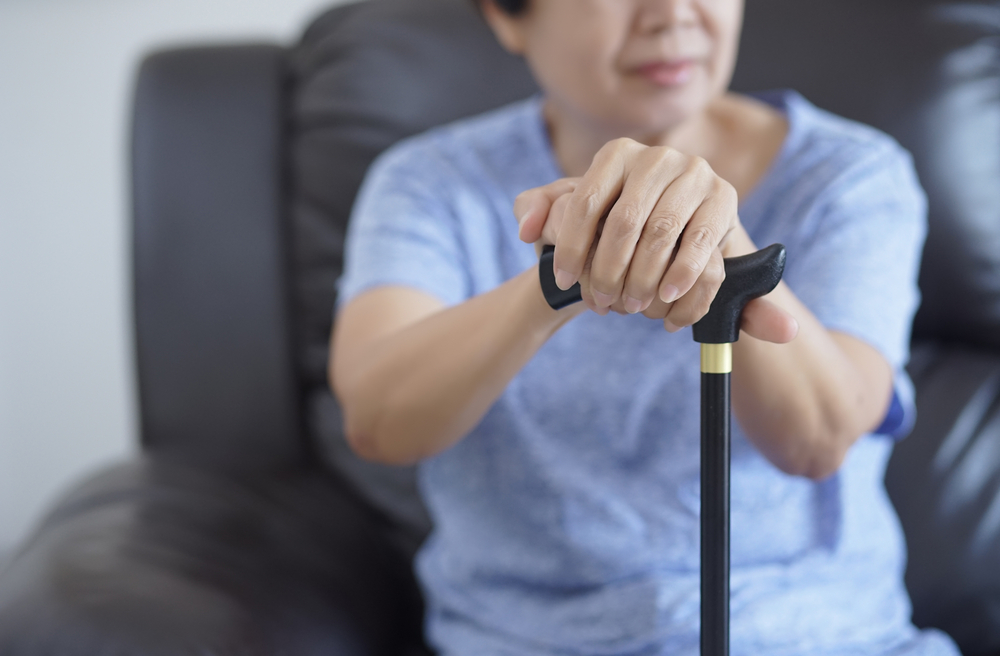 multiple sclerosis patient woman with cane