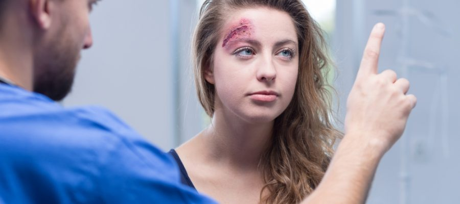 young woman tested for concussion symptoms
