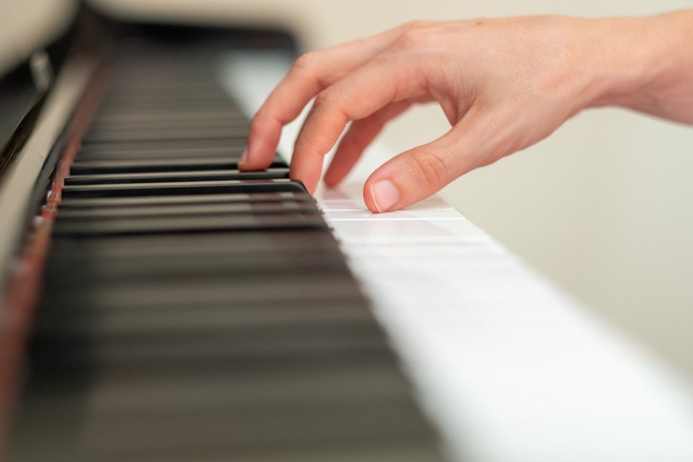 person with dystonia playing piano