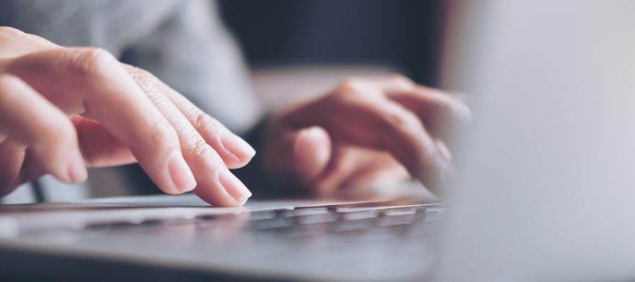 person with dystonia typing on keyboard