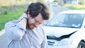 A man experiences neck pain after suffering a concussion in a car accident