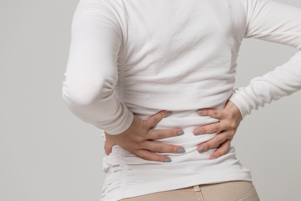 woman suffering back pain musculoskeletal disorder