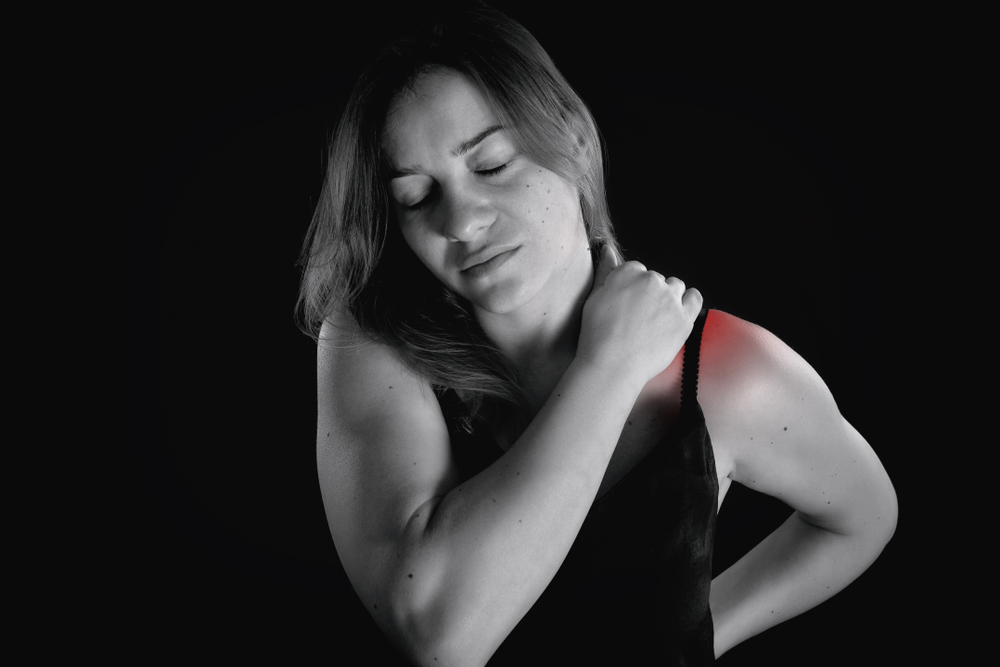 woman suffering shoulder pain musculoskeletal disorder