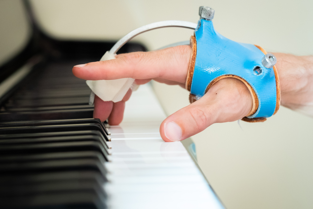 piano & hand of person with dystonia
